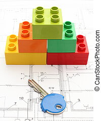 Colorful building blocks and key on housing plan - Colorful ...