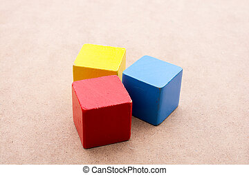 Colorful building blocks on brown background