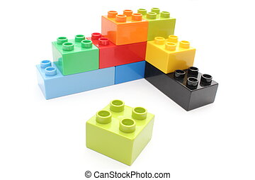 Colorful building blocks on white background - Closeup of ...