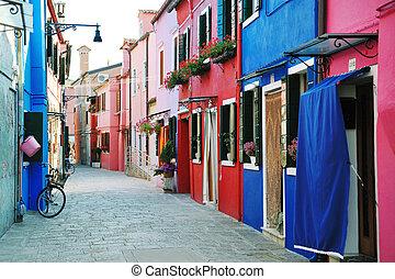 Colorful buildings in Burano island street, Venice