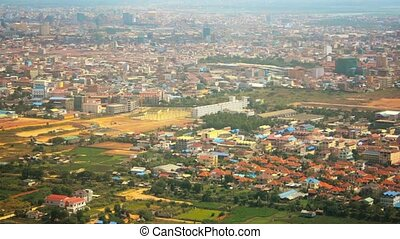 Colorful Buildings in Cambodian City from Landing Plane -...