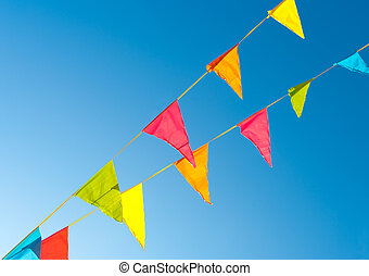 bunting flags - colorful bunting flags against a blue ...