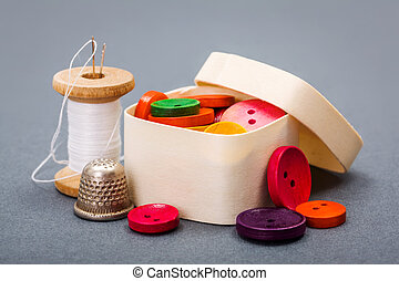 Colorful buttons in wooden box