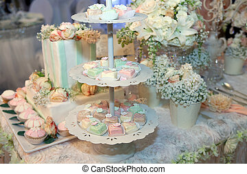 Colorful cakes on a banquet