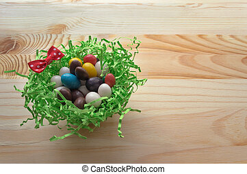 colorful candies in green nest with red bow