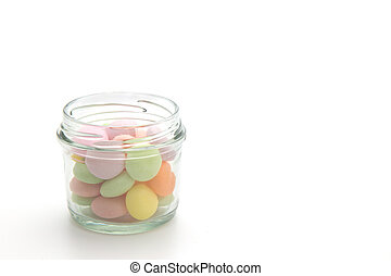 Colorful candies in jar isolated on white background