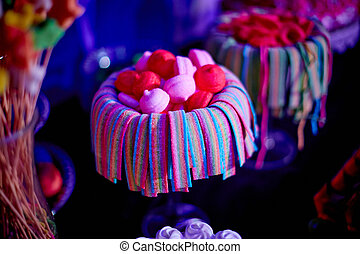 Colorful candies in jars on table. Sweets on the table