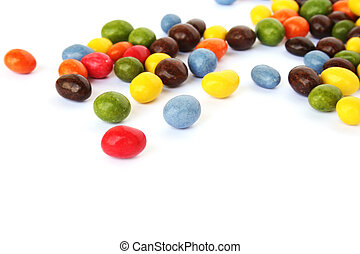 Colorful candies with raisins and peanuts isolated on white ...