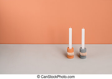Colorful candlesticks with wooden parts