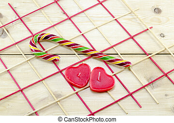 Colorful candy cane and heart shaped candles