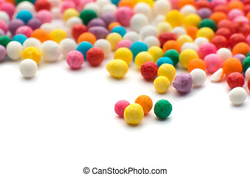 Colorful candy confetti on the white background