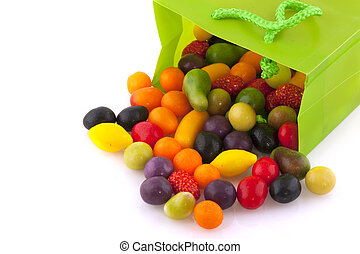 Colorful candy in green bag