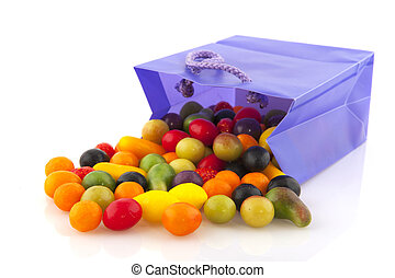 Colorful candy in purple bag