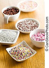 colorful candy sprinkles in ceramic bowl