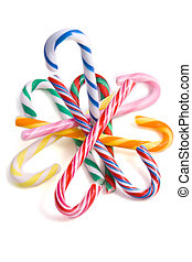 Colorful candycanes on a pile on a white background
