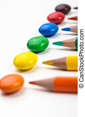 Colorful candys and penciles - Colorful penciles over white...