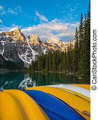 Colorful canoes at Moraine Lake, Banff National Park at sunrise