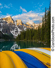 Colorful canoes at Moraine Lake, Banff National Park at sunrise