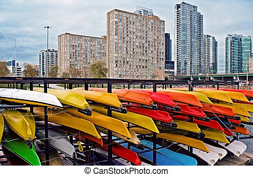 Colorful canoes in city