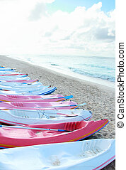 Colorful canoes in the beach