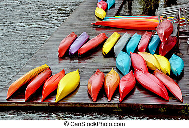 Colorful canoes on the dock