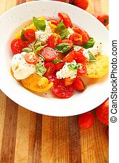Colorful caprese salad on cutting board