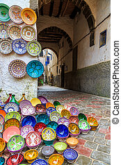 Colorful ceramic souvenirs on the street in a shop in Morocco