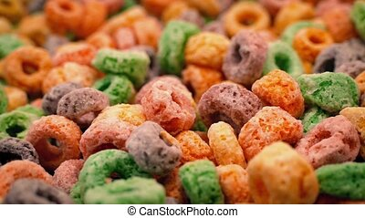 Bowl of colorful cereal hoops turning slowly