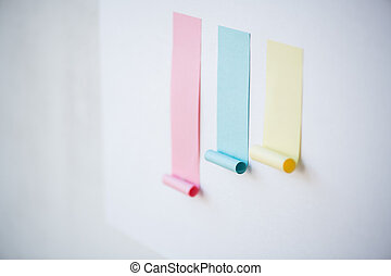Colorful chart made up of blank pink and smaller blue and yellow sticky papers