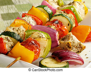 Seasoned chicken kebabs with bell peppers, onions, zucchini, and cherry tomatoes