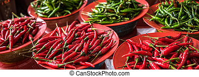 Colorful chilli peppers stall at asian market