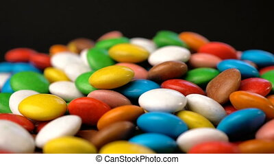 Colorful chocolate candy rotate background. Slow motion...