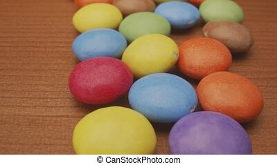 Colorful chocolate confectionery in camera motion