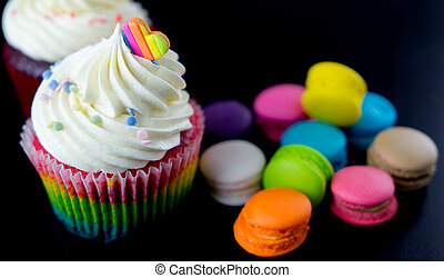 Colorful chocolate cupcake with macarons