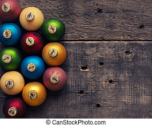 Colorful Christmas baubles on wood
