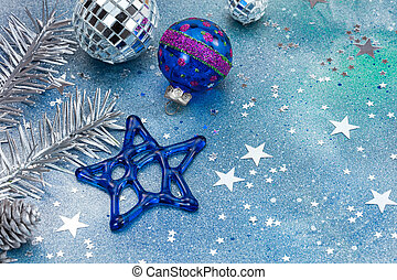 colorful christmas tree decorations on blue background with stars