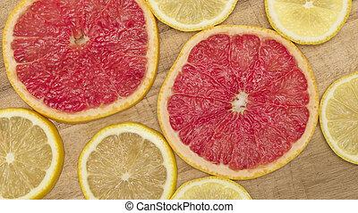 Colorful citrus fruit - lemon, grapefruit - slices background