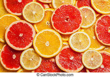 Colorful citrus fruit - lemon, orange, grapefruit - slices background