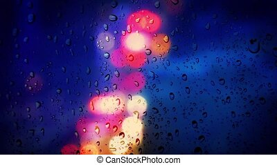 Colorful City Lights In Rain - Droplets on window in rainy...