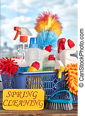 Colorful cleaning items in basket.