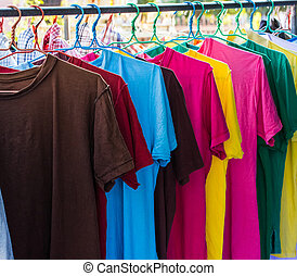 Colorful clothes drying on a washing line.