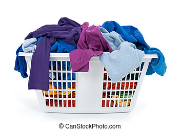 Colorful clothes in laundry basket. Blue, indigo, purple. - ...