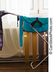 Colorful clothes on drying rack.