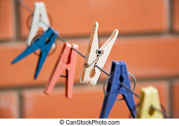 Colorful clothespin hanging on a clothesline