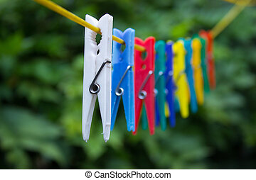 Colorful clothespins hanging on a clothesline