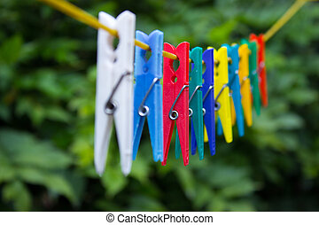 Colorful clothespins hanging on a clothesline (4)