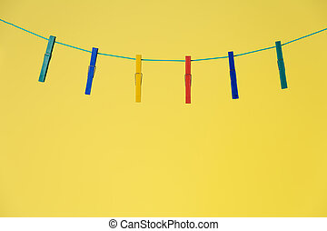 Colorful clothespins on rope
