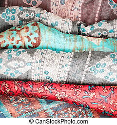 Selection of colorful asian and african cloths as a background