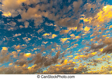 Colorful clouds in the blue sky of Latin America in contrast to the sunlight