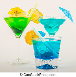Colorful cocktail decorated with fruit, colorful umbrella, ice cubes, party night, mix drink